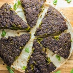 photo of kuku sabzi, arranged in a circle, over some bread.
