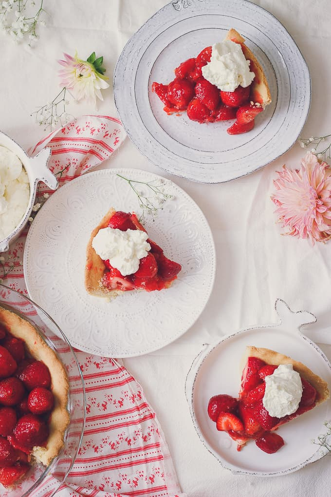 view of three pieces of fresh strawberry pie with whipped cream from the top