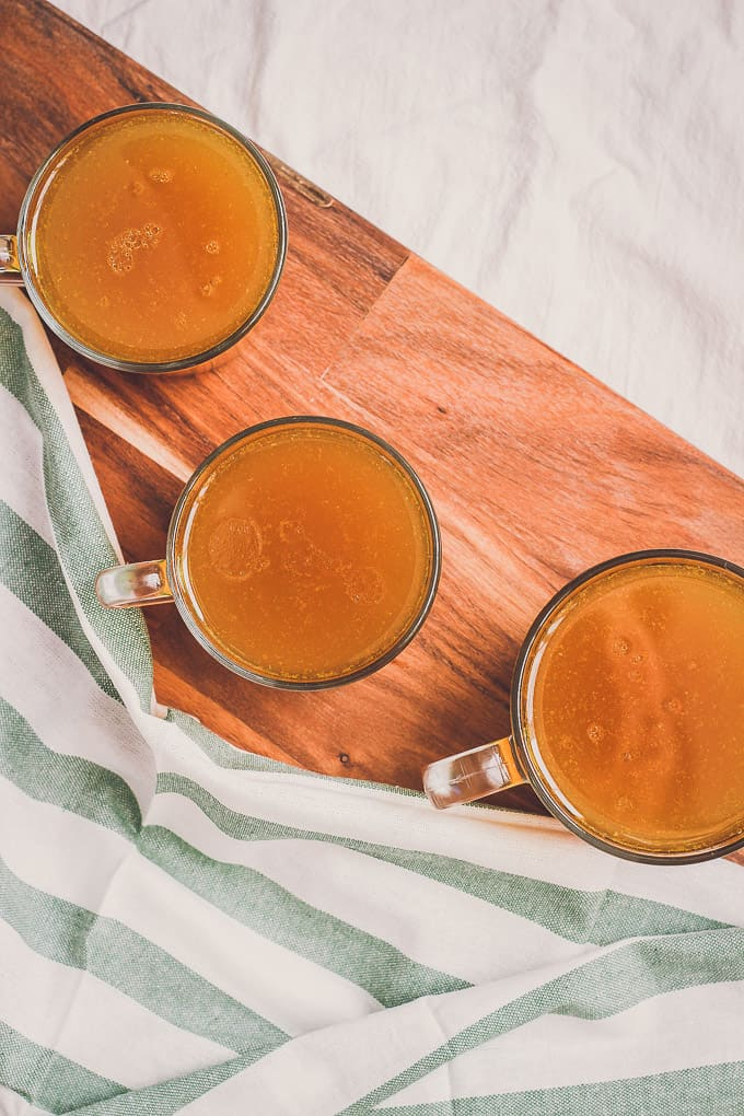 top view of very rich-looking bone broth with turmeric color