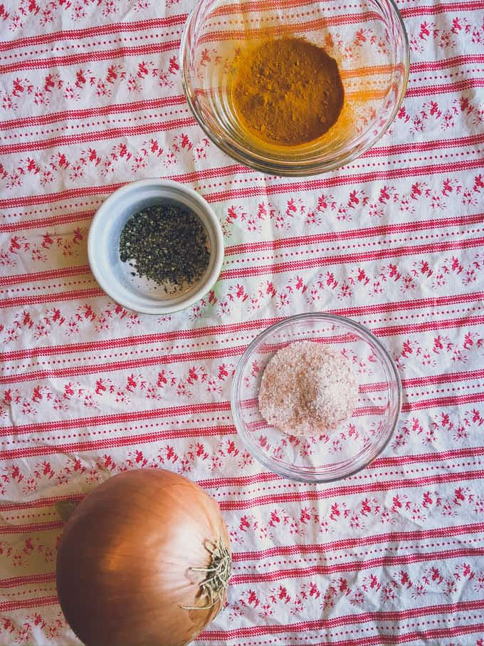 seasonings for the easiest bone broth recipe sitting on a tablecloth in little dishes